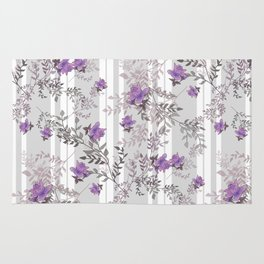 Lilac roses on a gray striped background. Rug