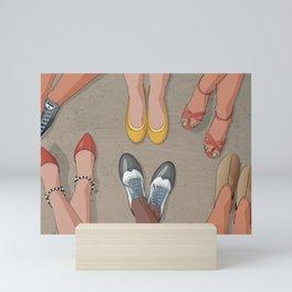 Feet movement under table Mini Art Print