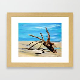 The swept away tree stands at low tide, in a gushy sand Framed Art Print
