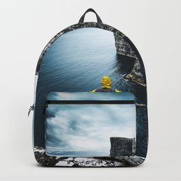 explorer on top of the rock Backpack