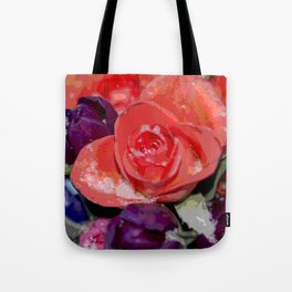 Snow settling on a top of Bouquet of flowers Tote Bag
