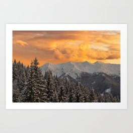 Orange clouds above mountains and spruce forest Art Print