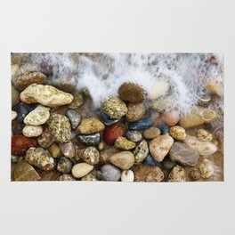Stones at the beach Rug
