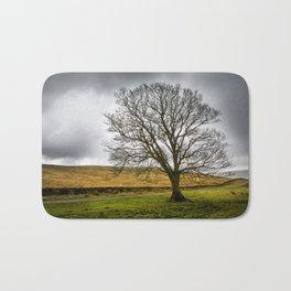 Single tree in stormy weather Bath Mat