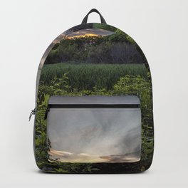 Smokey spring sunset in the woods Backpack