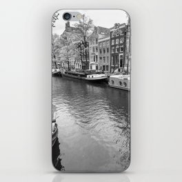 Houseboats docked on canals in Amsterdam iPhone Skin