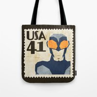 superheros Tote Bags featuring Blue Beetle  by Teighe Armour Thorsen