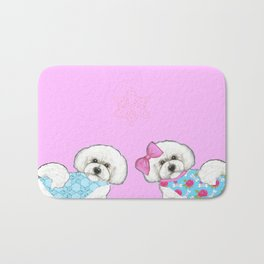 Bichon Frise Dogs in love- wearing pink and blue coats Bath Mat