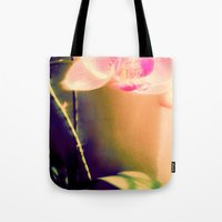 orchid Tote Bags featuring orchid by Eva Lesko