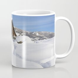 Heavy snow surrounds and lies a top a cabin in Steamboat Springs Colorado Coffee Mug