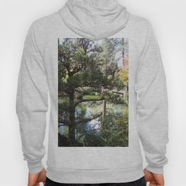 Peaceful Pond in Japanese Garden with Trees and a Bridge Hoody