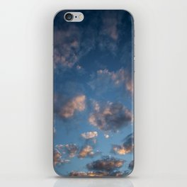 Blue sky with isolated clouds during sunset. iPhone Skin