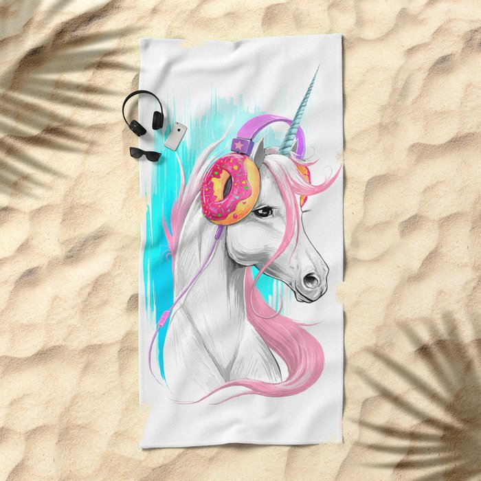 Unicorn in the headphones of donuts Beach Towel