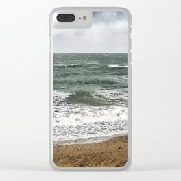 Land and sea under stormy clouds Clear iPhone Case
