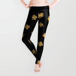 Golden shamrocks Black Background Leggings