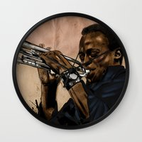 miles davis Wall Clocks featuring Miles, jazz will never be the same by The Art Warriors