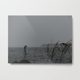The lighthouse in the storm Metal Print