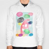 macaron Hoodies featuring A wild creature in a macaron rain by Konstantina Louka