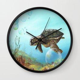 Green sea turtle swimming in ocean Wall Clock