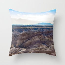 Looking across the Borrego Badlands Canyons towards the Hazy Mountainsin the Anza Borrego Desert Throw Pillow