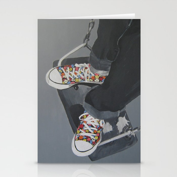 Flowered Converse shoes on a swing