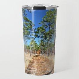 Dirt road through a pine forest Travel Mug