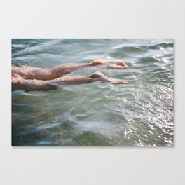 A child's legs in the ocean Canvas Print