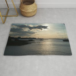 Lady Liberty in the Distance at Sunset Rug