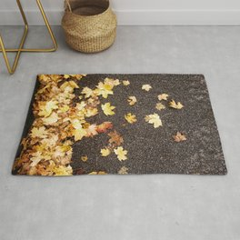 Gold yellow maple leaves autumn asphalt road Rug