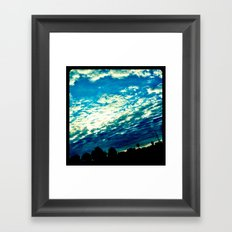Over the shoulder clouds. Framed Art Print