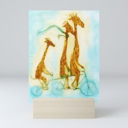 Family of giraffes rides a bicycle-tandem Mini Art Print