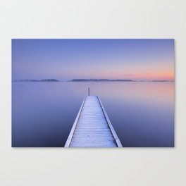 Jetty on a still lake in winter in The Netherlands Canvas Print