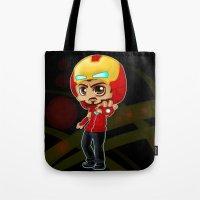 tony stark Tote Bags featuring Tony Stark - Iron Hooded by Kapika Arts