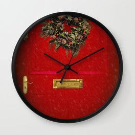 Christmas decorative wreath hung on red Victorian door with winter snow. Wall Clock