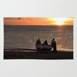 Fishing boat at sunrise Rug