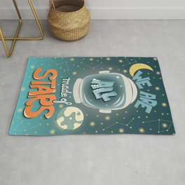 We are all made of stars, typography modern poster design with astronaut helmet and night sky, green Rug