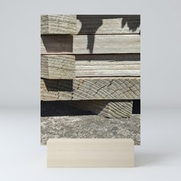 Stacked wooden planks Mini Art Print