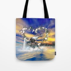 Dolphin jumps by a heart Tote Bag