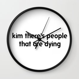 Kim There Are People Dying Wall Clock