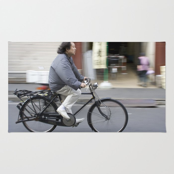 Riding a bike near Tsukiji Fish Market Rug