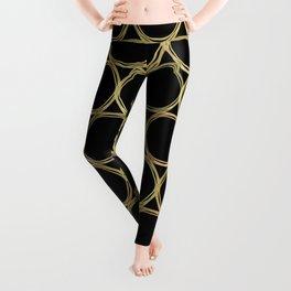 Gold Rings on Black Leggings
