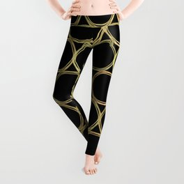 Gold Rings on Black Leggings