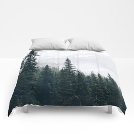 Evergreens in the fog Comforters