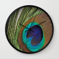 peacock feather Wall Clocks featuring Peacock Feather by aquenne