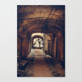 Silhouette of a man at the end of the tunnel in a medieval city Canvas Print