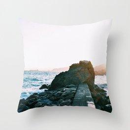 Rock in the sea Throw Pillow