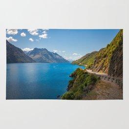Scenic winding road at Lake Wakatipu, New Zealand Rug