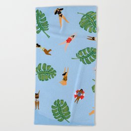 Floating in the sea Beach Towel