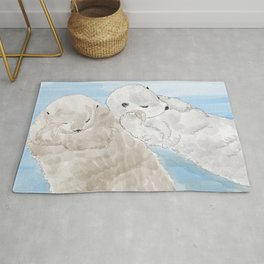Otters hold hands Rug
