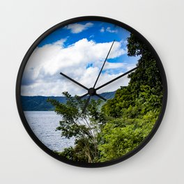Trees and Tropical Jungle Plants Line Laguna de Apoyo Lake in Nicaragua Wall Clock